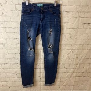 Wax jeans with rolled hems and distressing details